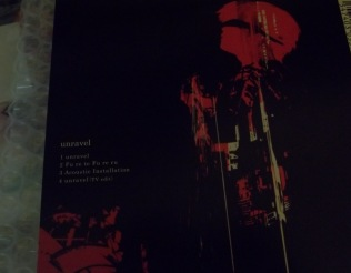 Unravel by TK from Ling Tosite Sigure Limited CD backside